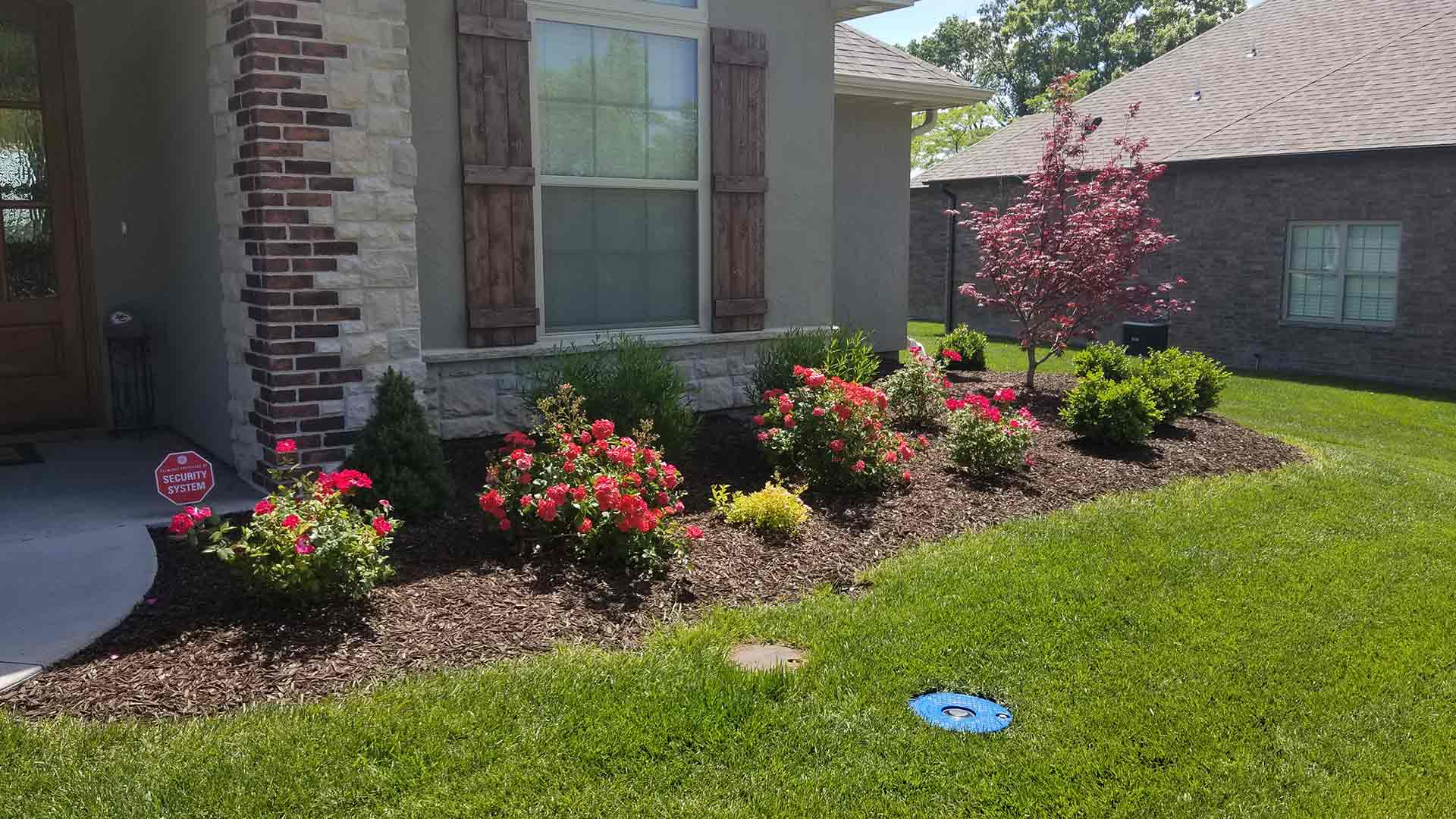 Newly installed landscaping by McVey Mowing at Columbia, MO home.