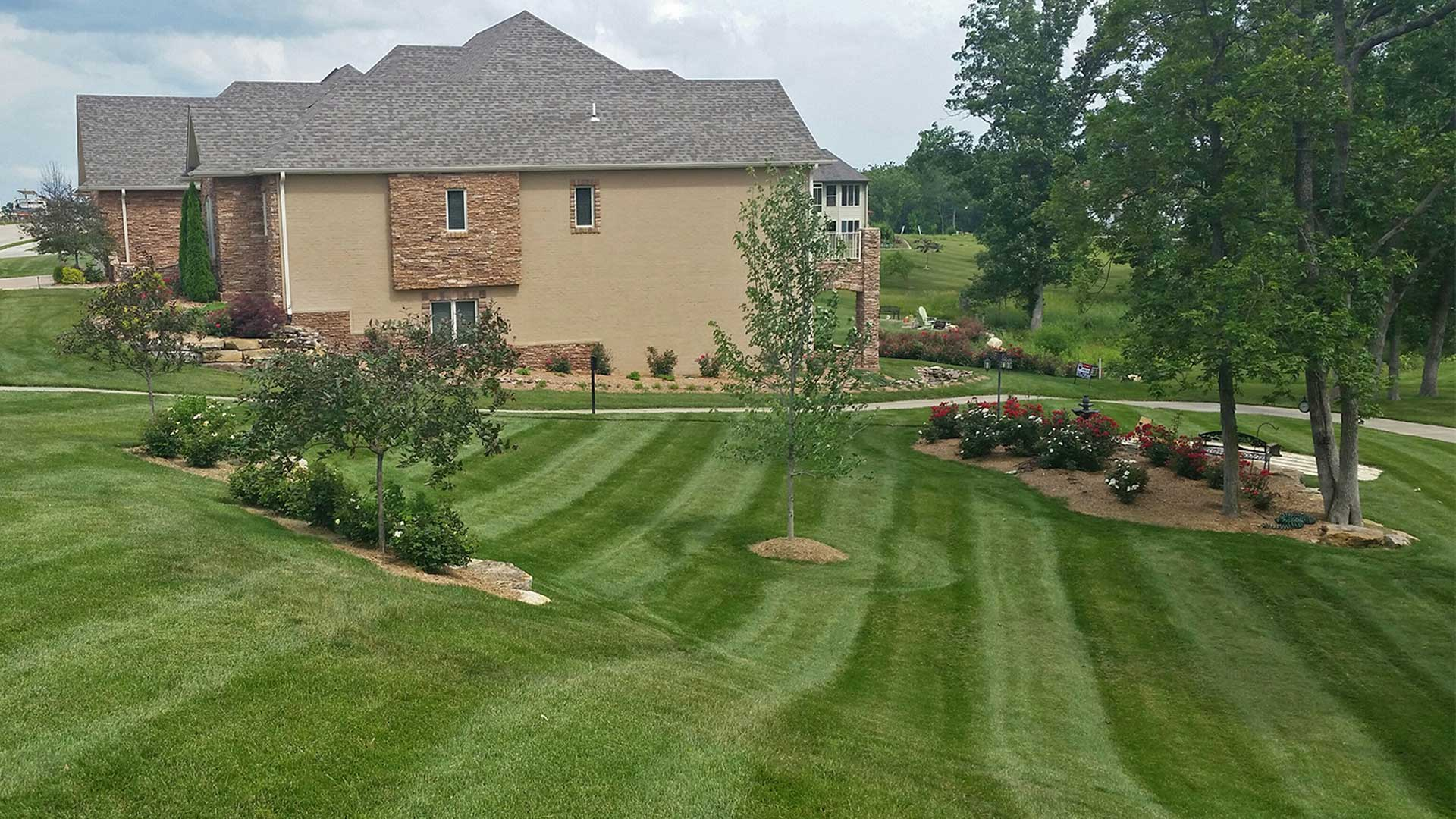 Well maintained lawn and landscaping at residential property.