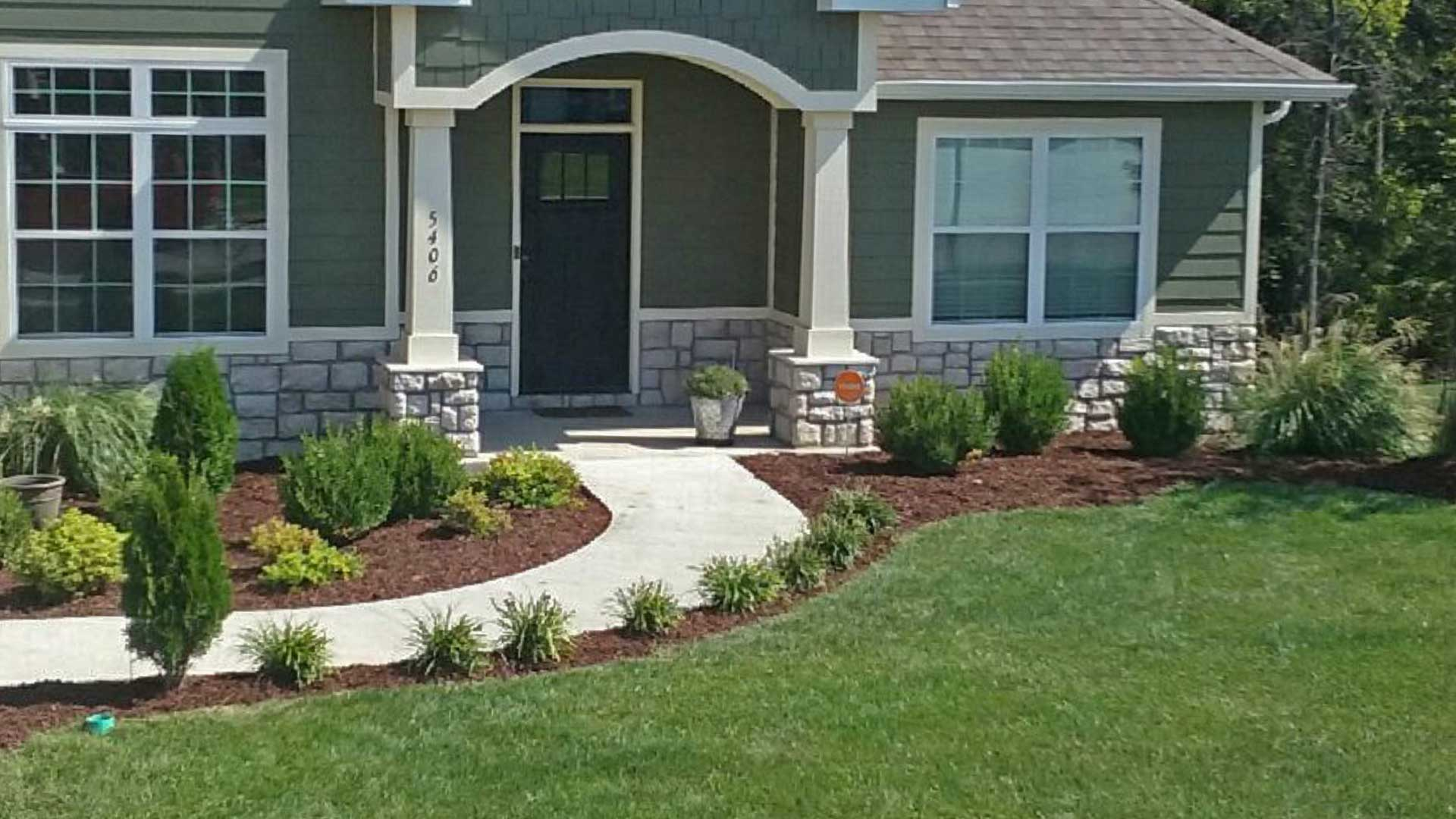 Columbia, MO Home with New landscaping and lawn maintenance by McVey Mowing.