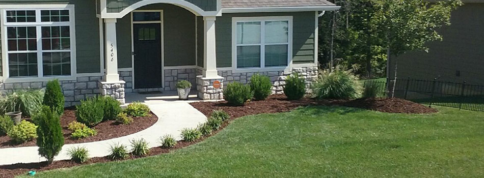 Columbia, MO home with new landscaping in the front by McVey Mowing.
