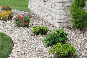 New rock mulch laid in landscape bed at Columbia home.